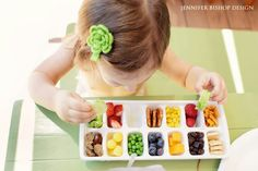 Toddlers don't eat much but using an ice tray for their birds like appetites could be a fun way to get them to eat of a variety of  different healthy foods