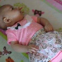 "Love cats? You'll love this ""Catnip"" onesie skirt set. Pink polka dots, lace, and a tiny black bow. So sweet!"