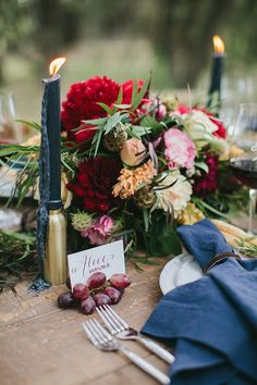 I love the navy element with the brass and red/cranberry florals. Maybe we can use some navy taper candles in the space....