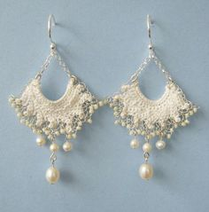 Chandelier earrings made with handmade lace, which is first stitched with ivory colored wire, then extra fine silver wire is used to embellish the lace finished with tiny glass beads along the edge.  Freshwater pearls add movement to these chandelier style earrings, which are about 5 cm in length.