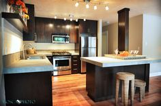 This looks alright to me, so I guess dark could work maybe.  Might have ot be stainless appliances though...    SW 45th - contemporary - kitchen - portland - Mosca Photo