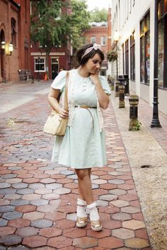 White frilly ankle socks, brown wedge sandals, clear blue dress, white lace spencer