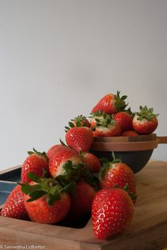 L1M2AS1 - NIKON D60 - STILL LIFE VERTICAL DEPTH OF FIELD - 1/1.6 - f22 - 18MM - ISO200. Taken indoors with natural light coming in on left of shot. Focus was on the strawberries in the bowl.
