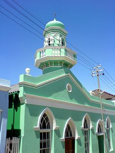 Cape Town Architecture, South Africa.  ** I love the colour of this building. The tower with the widows' walk is lovely also.