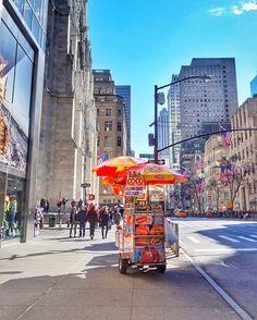 A street vendor on Fifth Avenue, Manhattan, New York. Have you ever tried the symbolic New York hot dog or pretzel? 😋  #newyork #manhattan #sky #spring #building #seeyourcity #nyc  #fifthavenue #streetvendor #timeoutnewyork #newyorkcity #citylife #hotdogstand #sunnyday #street