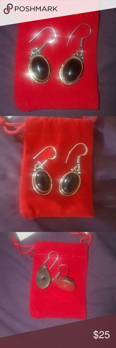 New - Sterling Silver Dangle Earrings Brand New- Sterling silver, antique look with black stones, about an 1 inch long. Very well crafted. Decent weight but not too heavy. Comes with red bag. Priced to sell- Earrings have already been reduced almost half off. Definitely a very nice pair of earrings. Simply just dont wear. Excellent condition. Jewelry Earrings