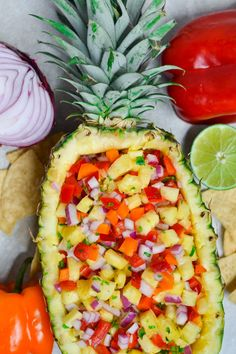 This pineapple salsa served in a pineapple boat is a serious show stopper! Not to mention delicious, too! It's naturally gluten-free, dairy-free, and vegan - making it the perfect party appetizer for all of your friends! Get the recipe at A Dash of Megnut Pineapple Boats, Pineapple Salsa, Easy Delicious Recipes, Yummy Food, Healthy Recipes, Easy Recipes, Healthy Party Foods, Appetizers For Party, Appetizer Recipes