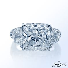 JB Star Diamond ring featuring a stupendous 8.39 ct cushion diamond handcrafted in a classic 3-stone setting with trapezoid and shield diamonds.  Available at Alson Jewelers.  216-464-6767