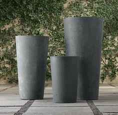 Restoration Hardware cast stone planters, for the top of the stairs