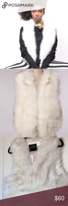 White & Brown Countess Faux Fur Vest Fluffy, soft faux fur vest. White with brown highlights. 70% Acrylic 30% Polyester Countess Jackets & Coats Vests