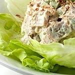 Cut chicken into 1/2-inch cubes.   Mix celery, mayonnaise, mustard, and parsley in a bowl.  Add chicken and toss