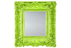 Cheap picture frames/mirrors painted with neon paint. (Like in workroom)