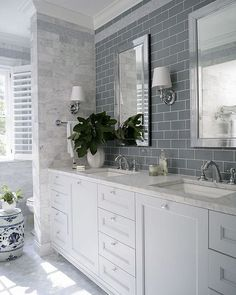 Love it! Tile behind mirror. But I'd need mirrors to go lower if I want to be able to see when seated, right?