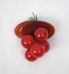 A classic mid-century Bakelite cherry dangle brooch (I have wanted this since I saw a picture in a fashion history book as a child! One day!!!)
