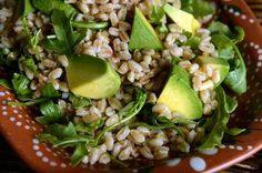 A salad made with farro, a hearty grain, with arugula and avocado