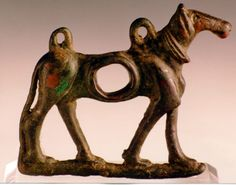 Luristan Harness Piece in the Form of a Horse -  Origin: Central Asia Circa: 900 BC to 600 BC Dimensions: 3.25 (8.3cm) high x 4 (10.2cm) wide Collection: Near Eastern Medium: Bronze
