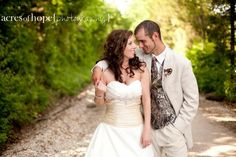futuremrsg2011's husband, Shane, had a wedding day look that showed off a dressed-up version of his outdoorsman personality. He wore a khaki suit and Mossy Oak camouflage vest and tie, bringing a perfect balance of elegance and laid-back signature style.