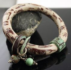 <3 Bangle Bracelet Earth Colors Turquoise Brown Bone.  via Etsy.  Like the beads