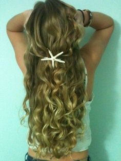 Curly hair with a star fish pin... Cute!