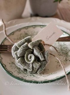 This looks like a flower made out of lambs ear! How cute!