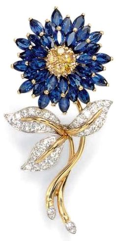 Brooch with a pavé-set yellow diamond bombé pistil, extending three tiers of marquise-cut sapphire petals, to the gold and diamond stem, with circular-cut diamond leaves, mounted in platinum and gold. By Oscar Heyman & Brothers. Gems Jewelry, Jewelry Accessories, Fine Jewelry, Jewlery, Flower Jewelry, Flower Earrings, Crystal Jewelry, Jewelry Art, Jewelry Ideas