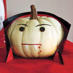 I love painting pumpkins at Halloween. Love the cape on this guy.