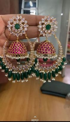 Gorgeous one gram gold earrings with jumkhi hangings. Earrings studded with multi color CzS. Gold Jhumka Earrings, Indian Jewelry Earrings, Jewelry Design Earrings, Gold Earrings Designs, Indian Wedding Jewelry, Ear Jewelry, Gold Jewelry, Pearl Jhumkas, Indian Jewelry Sets