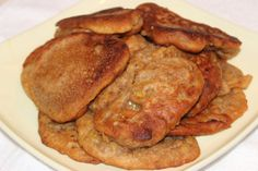 HOW - TO MAKE REAL JAMAICAN BANANA FRITTERS VIDEO RECIPE 2014 3 bananas, 1/2 cup sugar, 1 cup flour, cinnamon, nutmeg, vanilla, salt to taste. Cook in hot oil 3 minutes, flip, cook another few minutes.