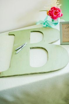 large letter guest book. navy letter with white writing. Or possibly oars for guests to sign
