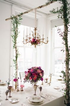 Create a gorgeous indoor garden with the table setting. A way to add hanging decor without using the ceiling or walls