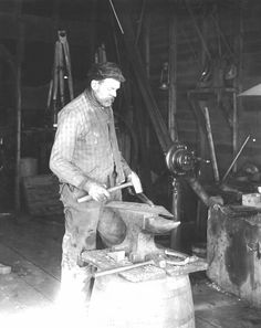 Blacksmith with Anvil and Hammers.