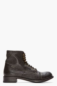 CHRISTIAN PEAU //  Black Lizardskin Military Boots  32526M047002  Ankle high lizardskin boots in black. Round toe. Black lace up closure with gold tone eyelets and lace hooks. Tonal stitching. Varanus salvator upper, leather sole. Made in Japan.  $835 CAD