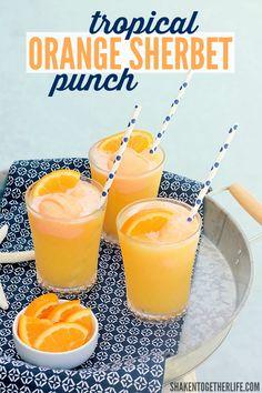 Tropical Orange Sherbet Punch is on repeat this Summer! Tropical fruit juices, lemon lime soda and scoops of orange sherbet make this punch a family favorite!-shaken together life