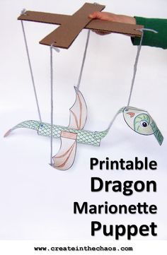 Such a fun craft! Printable dragon marionette craft for kids www.createinthechaos.com
