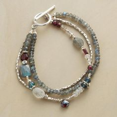 NIGHT SKY BRACELET–Ever-shifting shades of blue and gray and the warm glow of garnet give this handmade bracelet a lovely understated beauty. It glows with moonstone, labradorite, garnet, blue topaz, and aquamarine. Sundance Jewelry, Ideas Joyería, Custom Jewelry, Unique Jewelry, Dainty Jewelry, Bohemian Jewelry, Modern Jewelry, Bijoux Diy, Schmuck Design