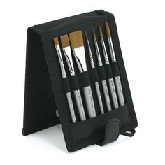 "Designed for the traveling watercolor painter, The Richeson Plein Air Travel Brush Set fits into a backpack and flips open to be used as a brush holder. The brush set includes three Flats (Sizes 1/4"", 1/2"", and 3/4""""), and four Rounds (Sizes 2, 4, 6, and 8). The high quality golden synthetic brushes make them perfect for water media. Pair this set with a postcard or small watercolor block and travel paint set for a complete plein air experience. #giftideas"