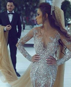 The beading on this long sleeve wedding dress is incredible. Beading like this can also be costly. But our American dress design company can make Custom #weddingdresses that are inspired by a haute couture design that is a fraction of the original cost. For more I go on #inspiredweddingdresses and custom designs go to www.dariuscordell.com/