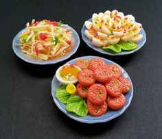 1/6 SCALE MINIATURE THAI FOOD  This listing is for 3 plates of yummy Thai food = papaya salad, fish cakes and son-in-law hard boiled eggs. Each plate