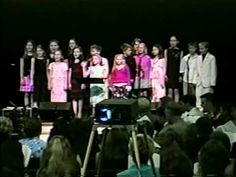 """O, the Glory Did Roll"": children at the Stamps-Baxter School of music leading a Gospel song"
