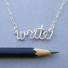 I so want this! :) write (sterling silver wire word necklace). $36.00, via Etsy.