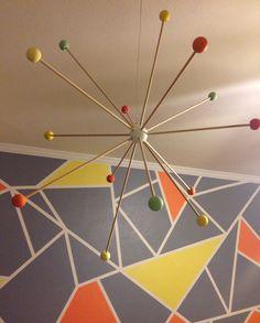DIY Sputnik Mobile + Amazing Geometric Shape Accent Wall = #modernnursery LOVE! #summerinthecity