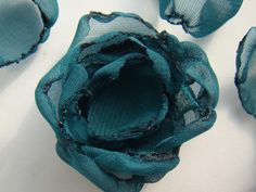 Fabric Flower Tutorial #7 The Burnt Edges Criss Cross Flower. Beautiful, tedious layers, and another chance to burn your fingers.