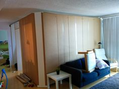 A temporary / removable wall creates an extra bedroom from ikea Pax wardrobes
