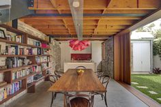Cool Cowshed House With Open Plan Interiors And Traditional Charm : Cowshed House With Wooden White Dining Table Chair Stool Chandelier Wooden Beams Kitchen Table Sink Oven Stove Cabinet Bookcase Sliding Glass Door Stone Floor White Dining Table, Dining Table Chairs, Dining Room, Sweet Home, Charming House, Shed Homes, Apartment Design, Bungalows, Location