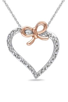 0.125CT Diamond Heart Pendant In Silver    This is beautiful!
