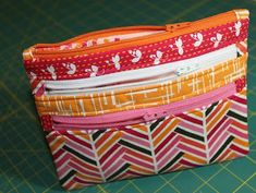 Triple-Zip Pouch :: A Tutorial I like how she finishes the ends of the zippers