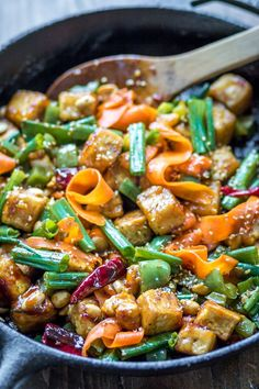 This spicy Hoisin Tofu Stir Fry is loaded with veggies and covered in a sticky sauce. On the table in under 30 minutes!