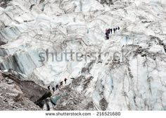 Teams of walkers crossing Fox Glacier, New Zealand
