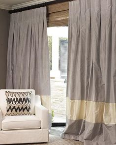 Banded silk curtain panels with inverted pleats.