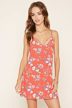 A mini dress featuring an open V-cut back, floral print, doubled-cami straps, and a V-neckline.
